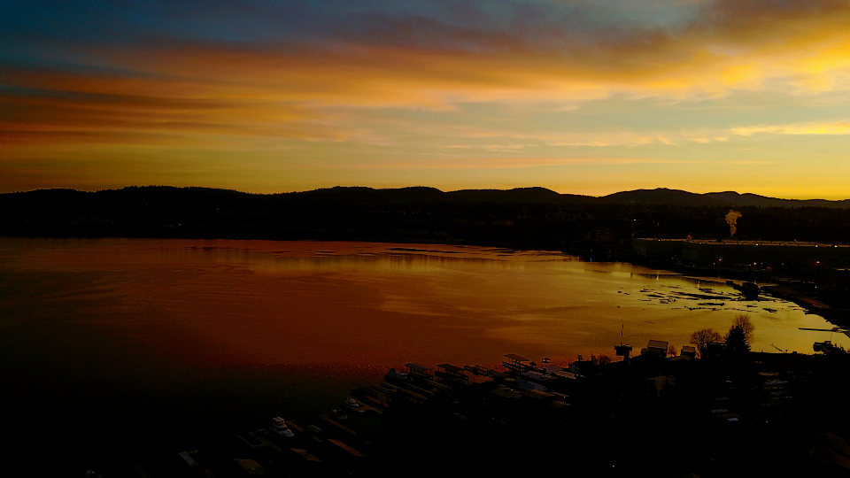aerial sunset drone sky clouds dusk evening lake golden water reflection mountains pond landscape shore dock