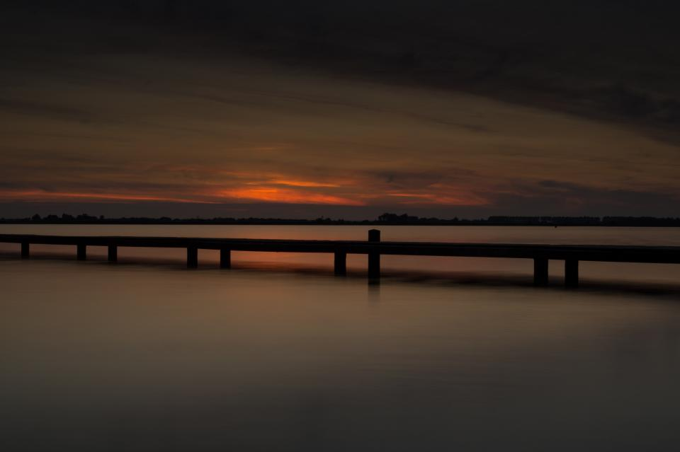 sunset pier water lake sky clouds dusk night dark
