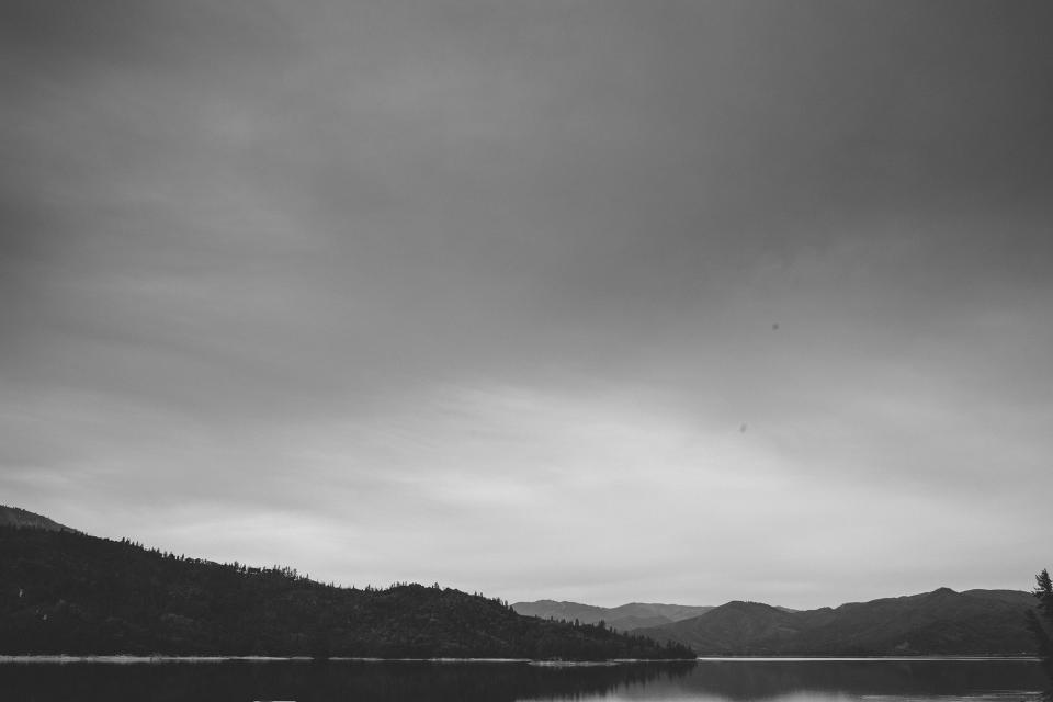 landscape mountains hills lake water sky clouds black and white nature