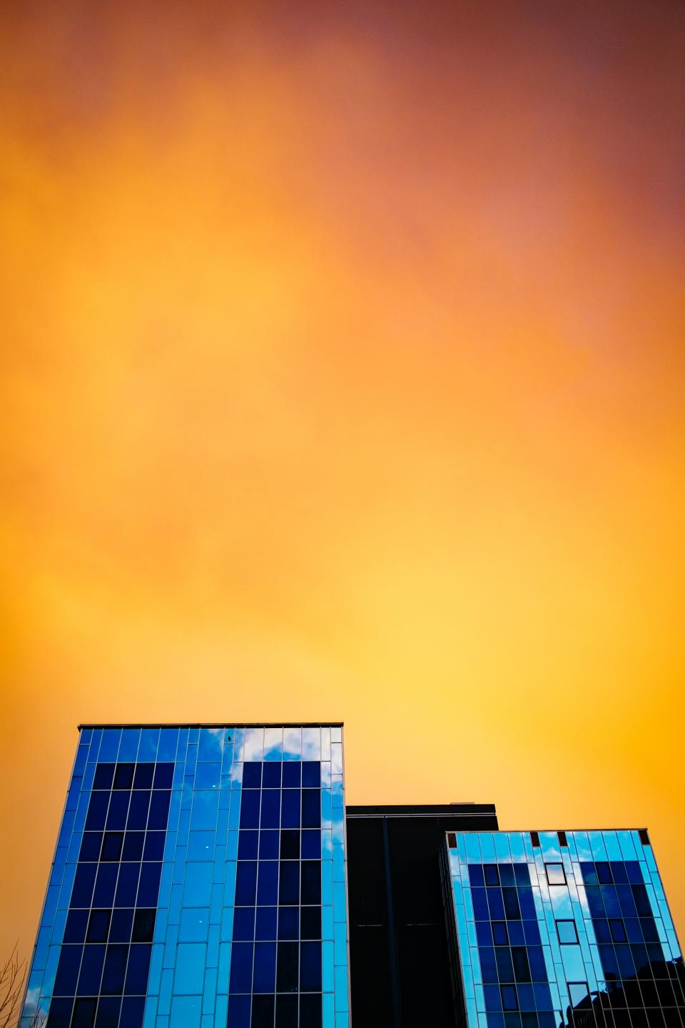 sunset dusk sky yellow buildings architecture windows
