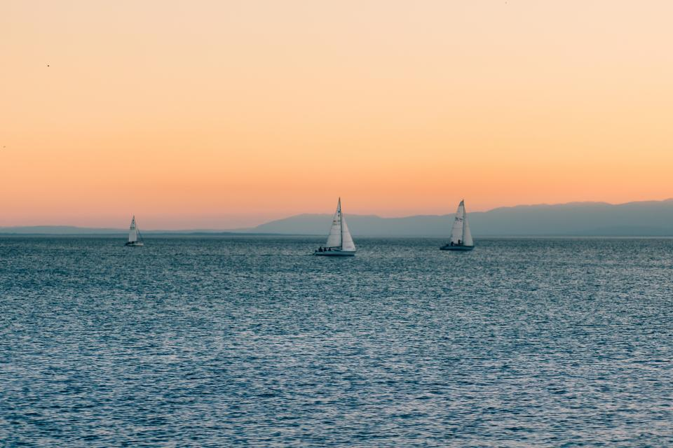sunset sky sailboats lake water horizon