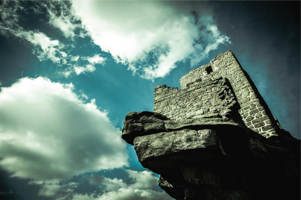 castle wall stones rocks blue sky clouds history