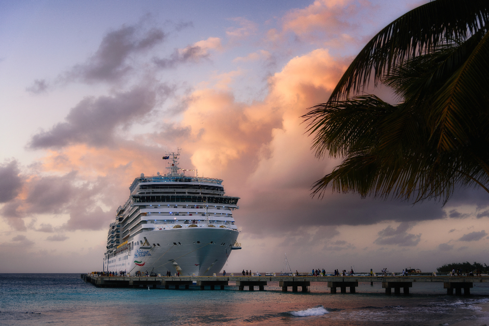 cruise boat water harbor dusk dawn travel vacation ocean ship sea caribbean passenger dock clouds palm tree
