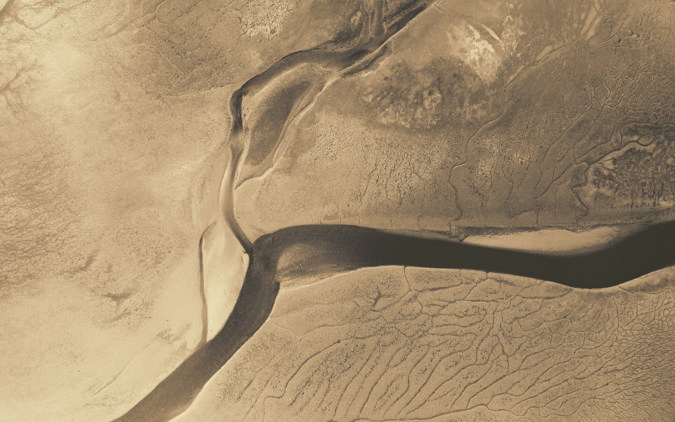 aerial sand water landscape drone above nature outdoors wetlands pattern abstract dunes monochromatic tan