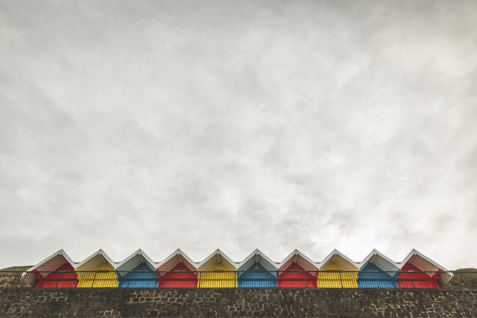house apartment color pattern roof clouds sky