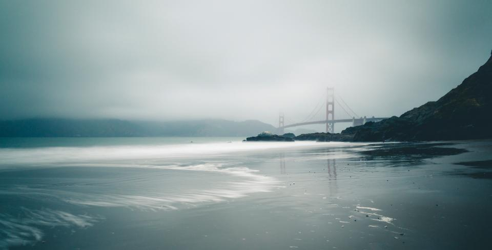 nature landscape water ocean sea beach travel adventure fog infrastructure bridge vacation