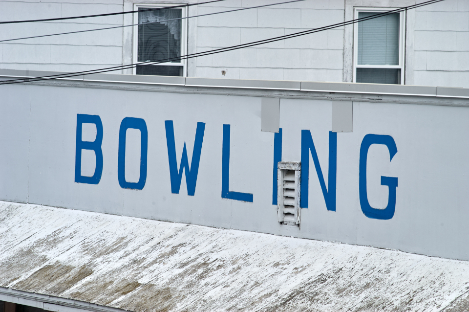 bowling sign old beach distressed outdoor vintage aged roof weathered entertainment fun advertisement business typography lettering