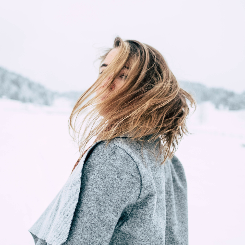 beautiful woman pose wind portrait snow mountains girl female hair face travel people