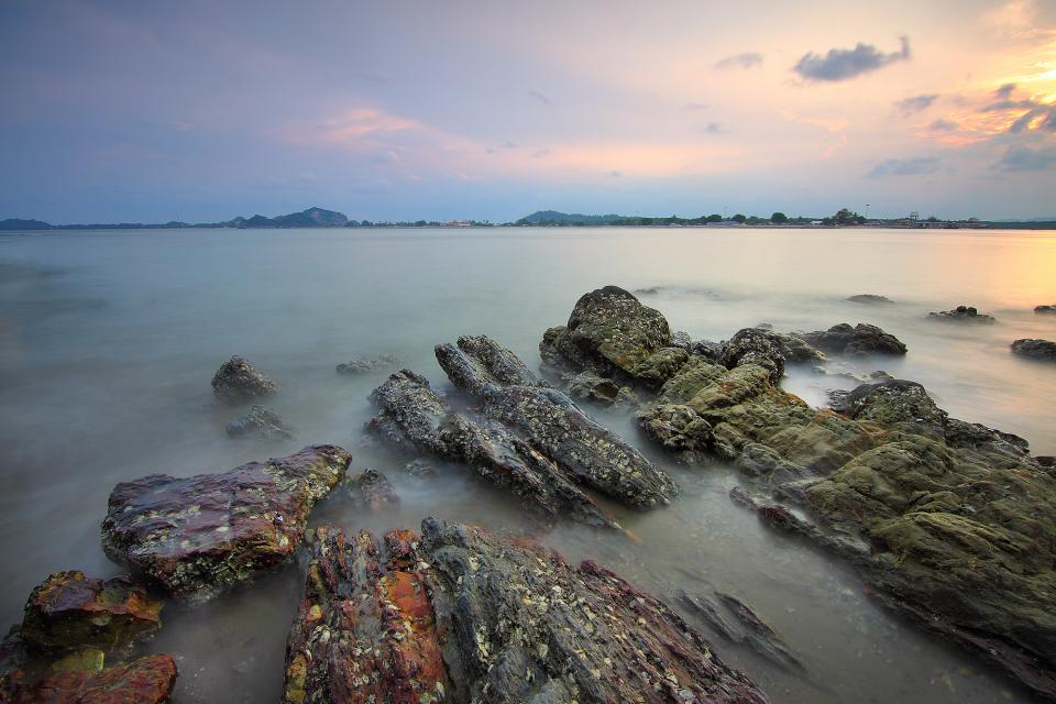 rocks sea water coast nature horizon cloud sky sunset