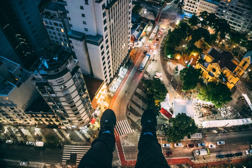 top aerial view building infrastructure church trees people crowd car road street lights city traffic park pedestrians legs shoes