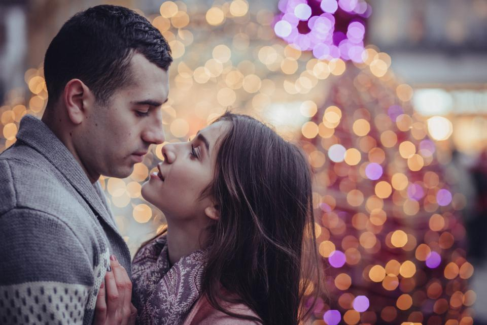 people man woman couple love intimate kiss hug christmas light bokeh sweet