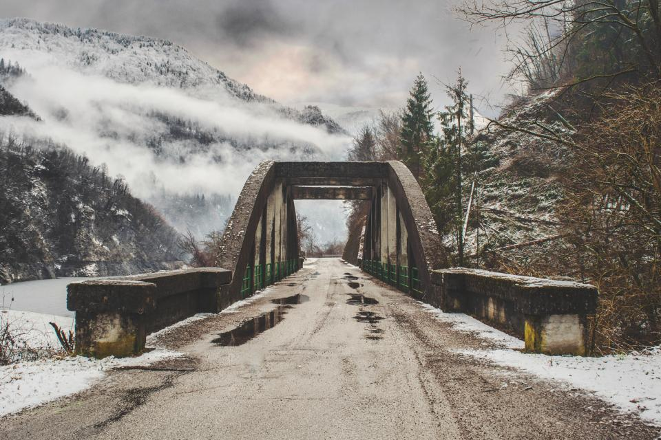 architecture infrastructure bridge snow winter cold weather fog clouds sky trees nature road travel adventure mountain