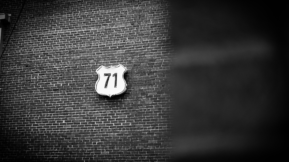 black and white brick sign 71 texture shadow car transport badge typography design
