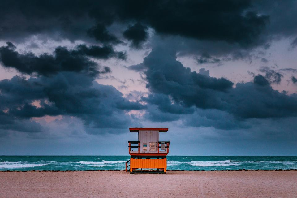 sea ocean water waves nature beach shore coast guard house security dark clouds sky outdoor