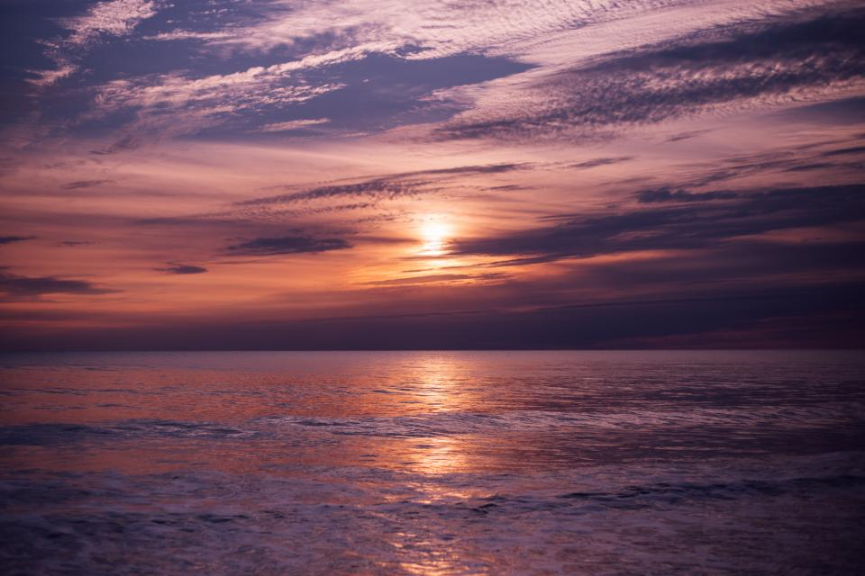 nature water ocean sea reflection sky clouds horizon sunset sunrise dusk dawn sun light violet purple