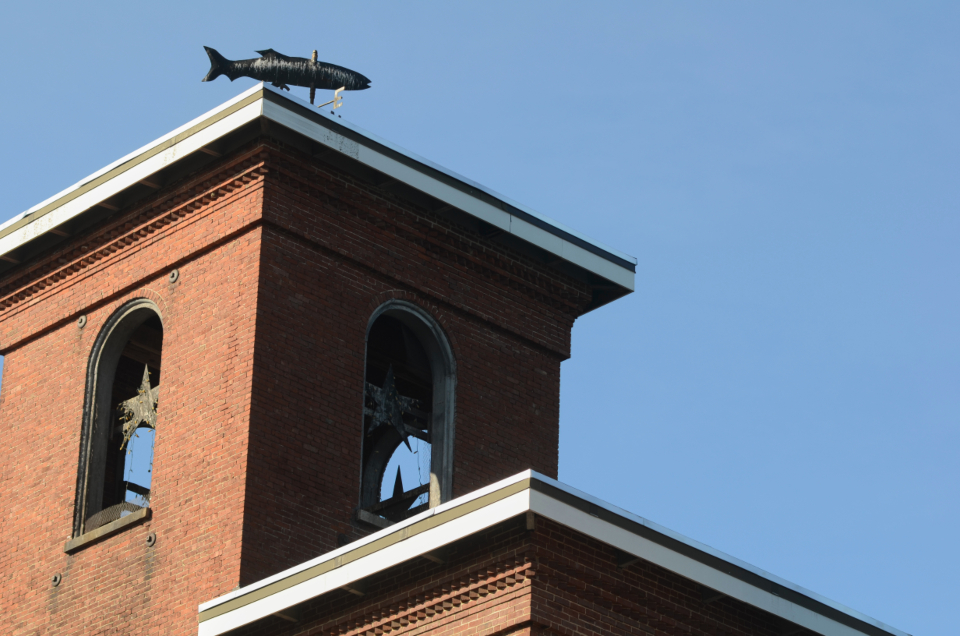brick mill building tower weathervane roof sky old design architecture industrial tall urban exterior