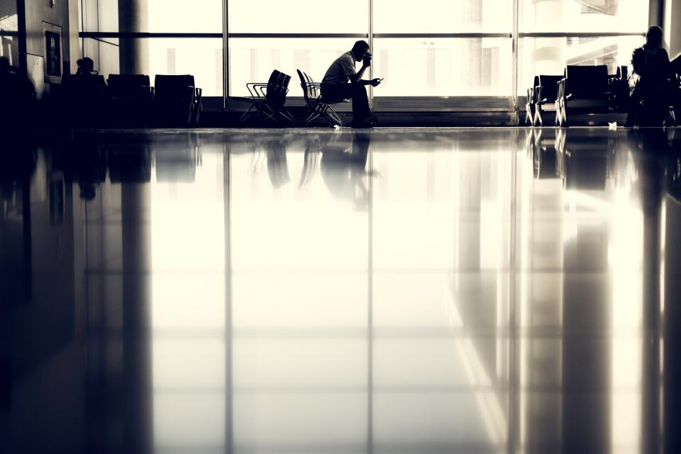 airport people waiting seats chairs windows reflection travel trip transportation