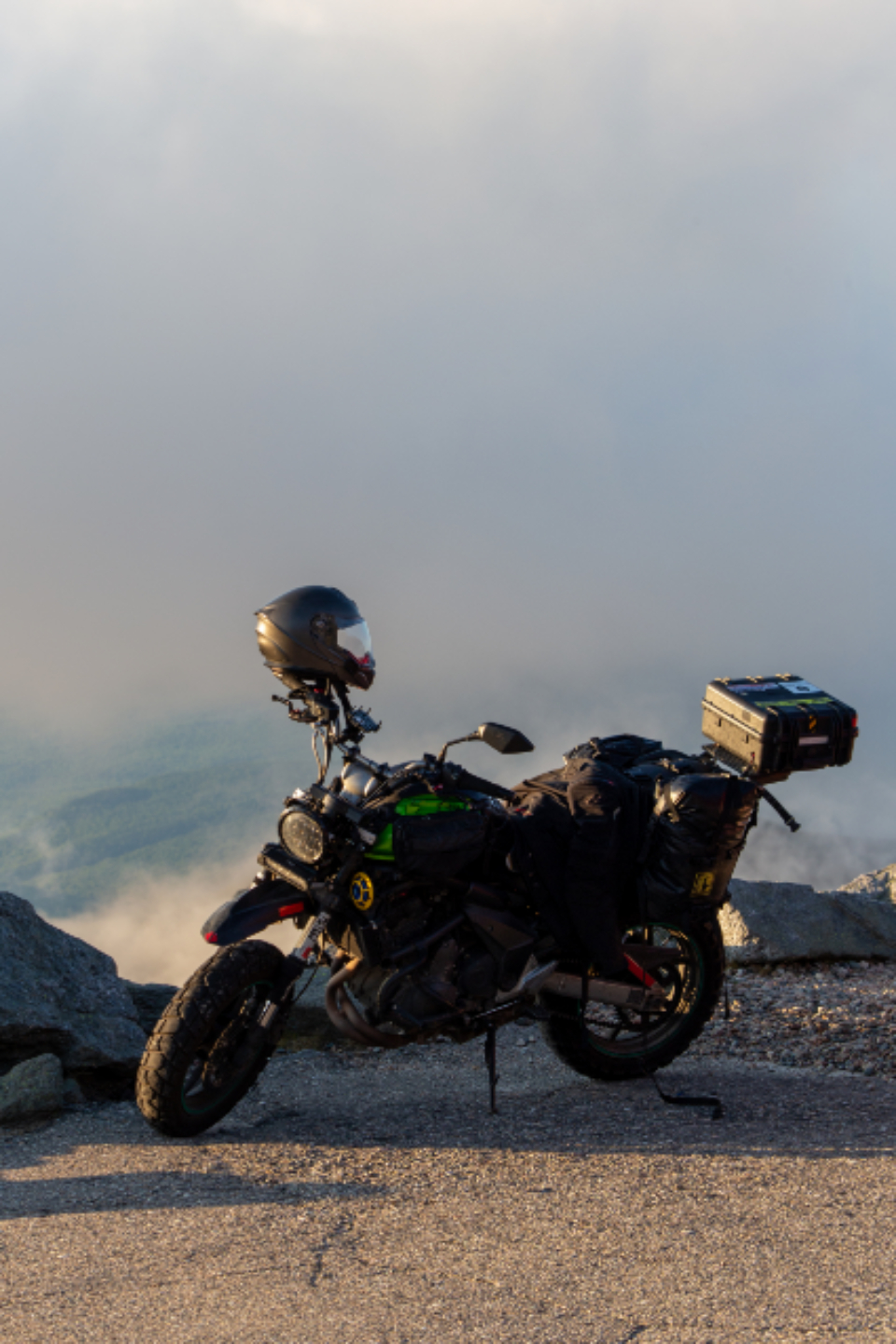 motorcycle mountain view journey ride peak helmet motobike touring tourist sky clouds parked bike scenic transport travel