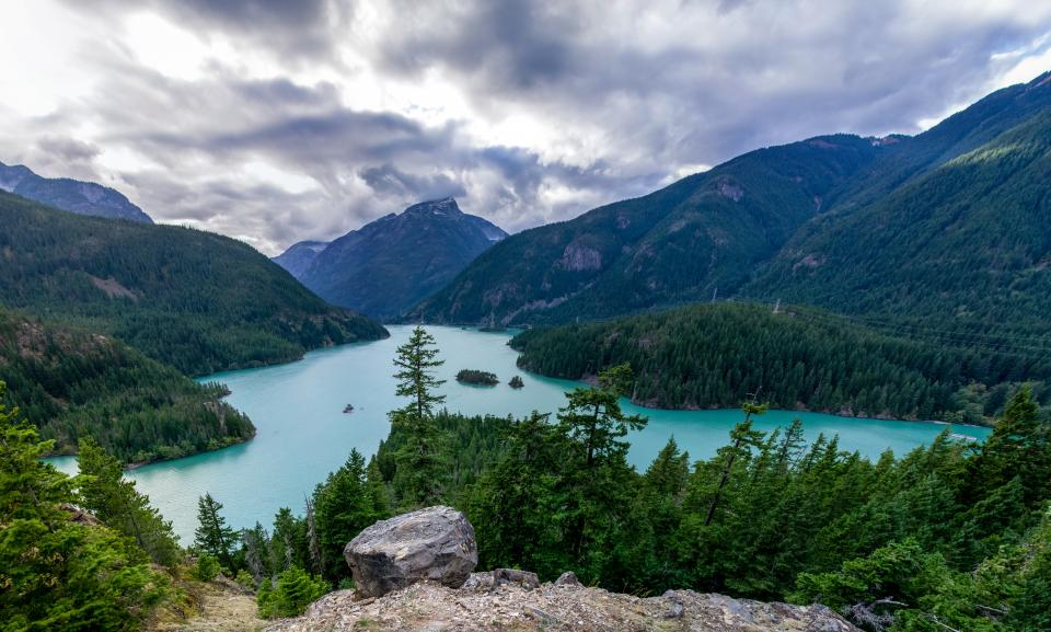 mountain valley landscape trees forest plant nature cloudy sky lake water rocks