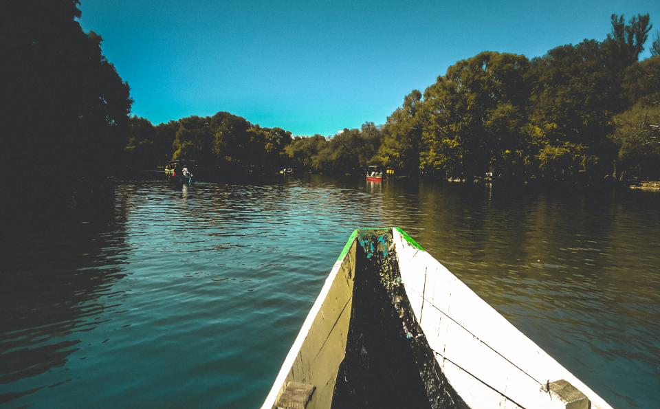 boat lake water nature trees green view sky wood people tourist