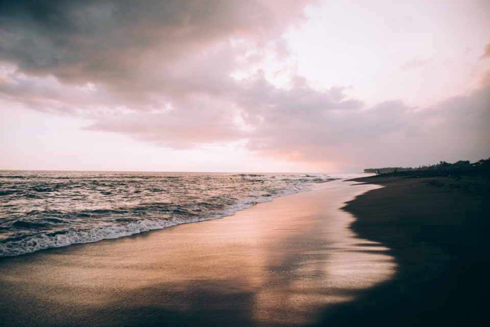 beach sand sunset seascape waves wet reflection sky clouds view ocean saltwater nature shore coast travel vacation