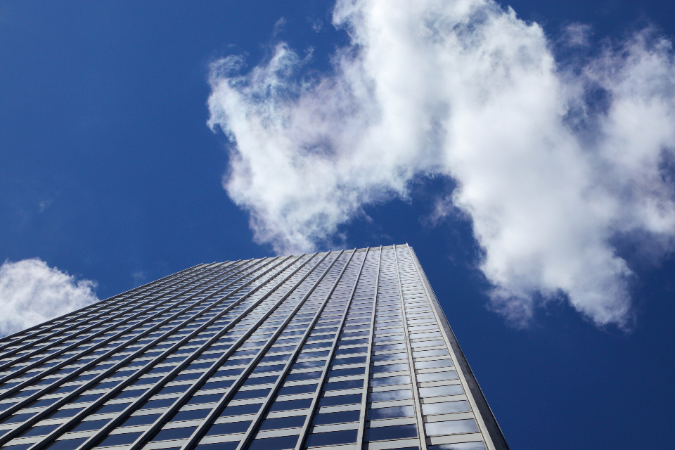 city building windows sky clouds downtown urban skyscraper architecture daytime business perspective exterior modern office
