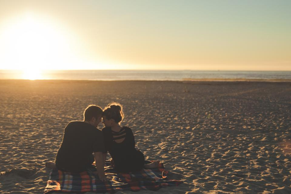 guy man girl woman people couple love blanket sunset beach sand ocean sea