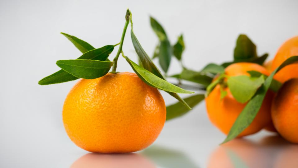 orange fruit table leaves fresh citrus healthy