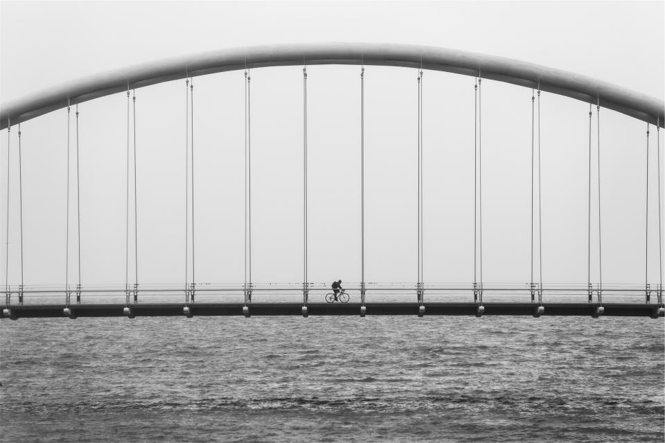 bridge architecture cyclist bicycle biker fitness exercise lake water black and white