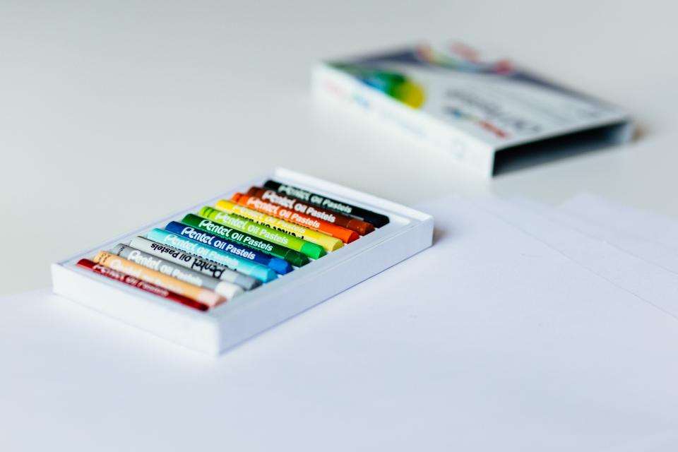 crayons color colorful art box white table blur