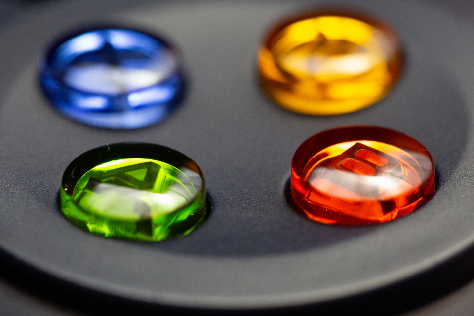 game controller buttons shiny colorful plastic fun play entertainment macro red yellow green soft focus blue tech