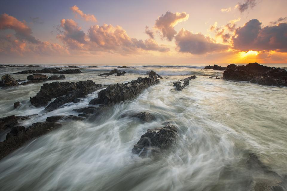 sea ocean splash ripples rock formation landscape nature waves adventure travel sky clouds sunset
