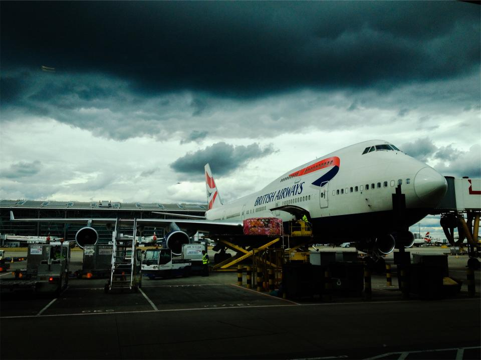 airplane airport luggage baggage British Airways travel transportation clouds cloudy storm dark boarding