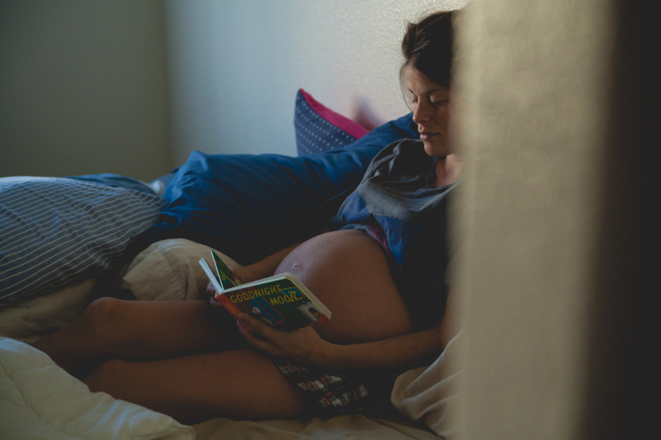 pregnant woman reading book bed belly heavily pregnant baby mother mom mum ma
