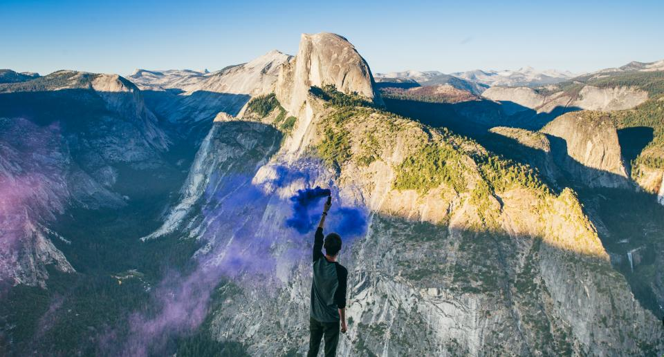 guy man male people back smoke art colors view mountains summit peak light shadows sky clouds horizon