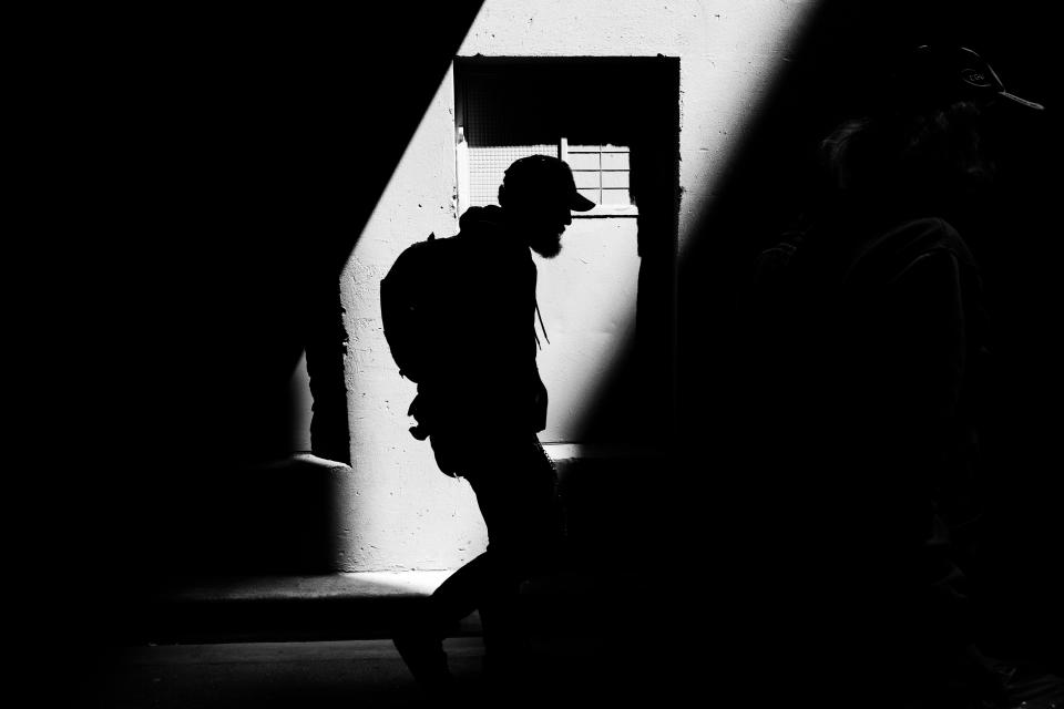 dark people man guy walking silhouette light black and white