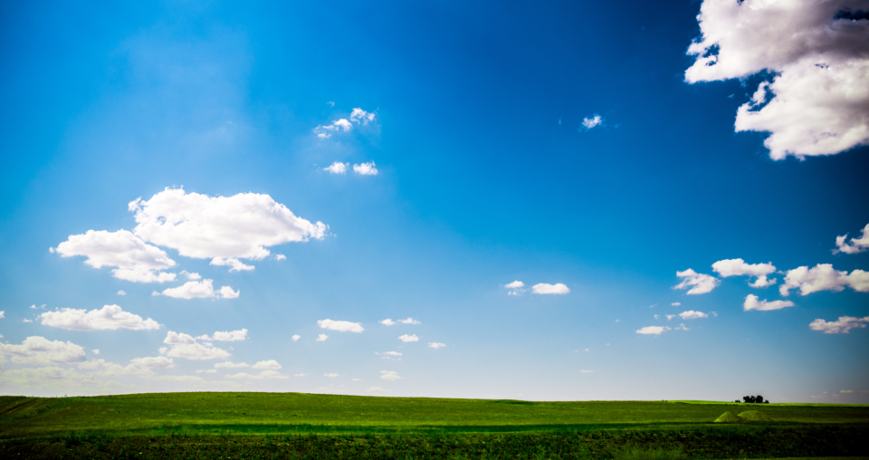 sunny landscape green grass grass blue sky sly clouds scenery earth