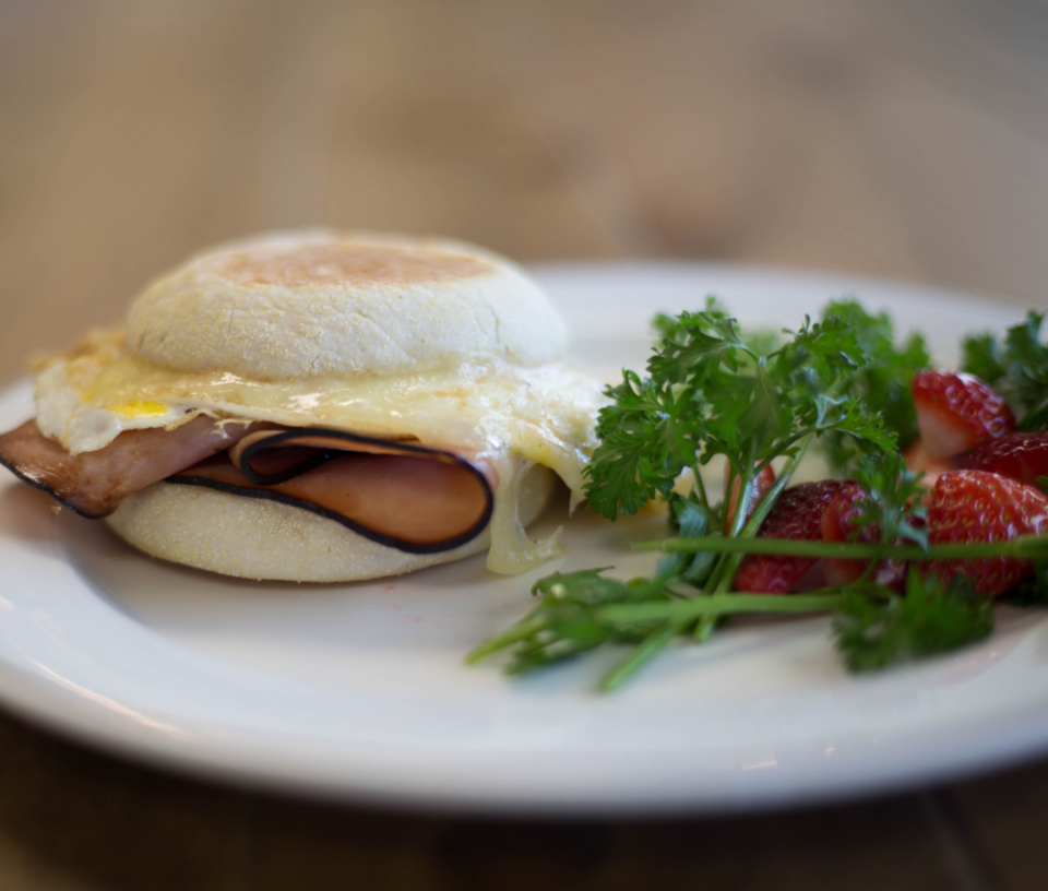 breakfast sandwich food egg ham bread deli cafe restaurant fastfood morning cheese parsley strawberry plate