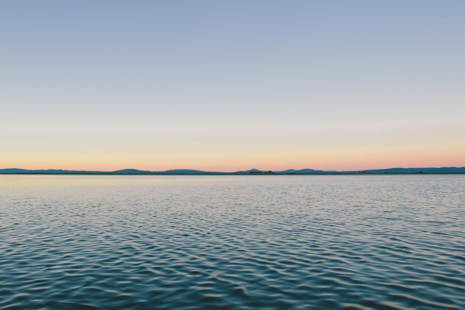 blue sky sunset lake water ripples outdoors mountains hills