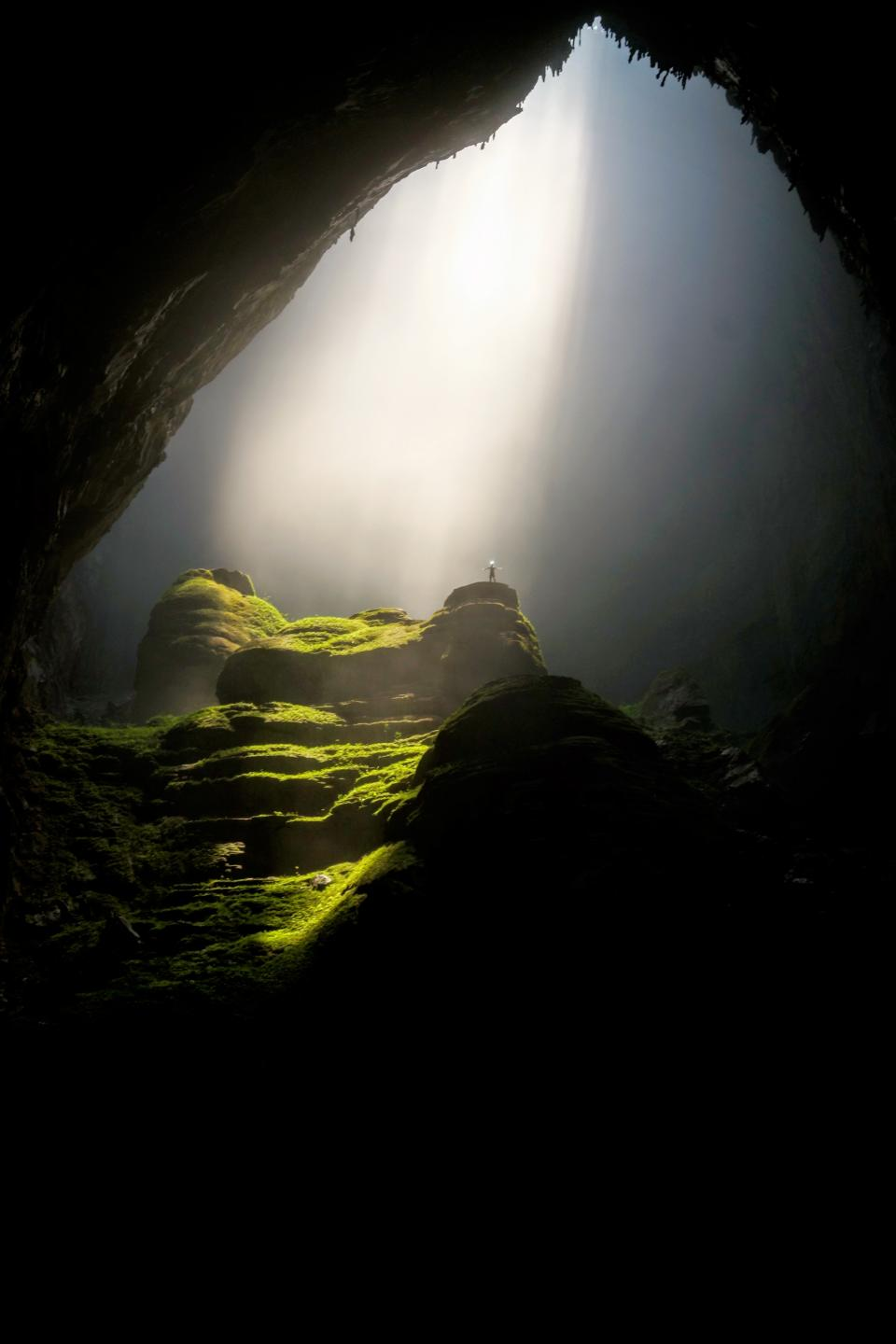 nature cave underground shadows light rays lush vegetation terraces