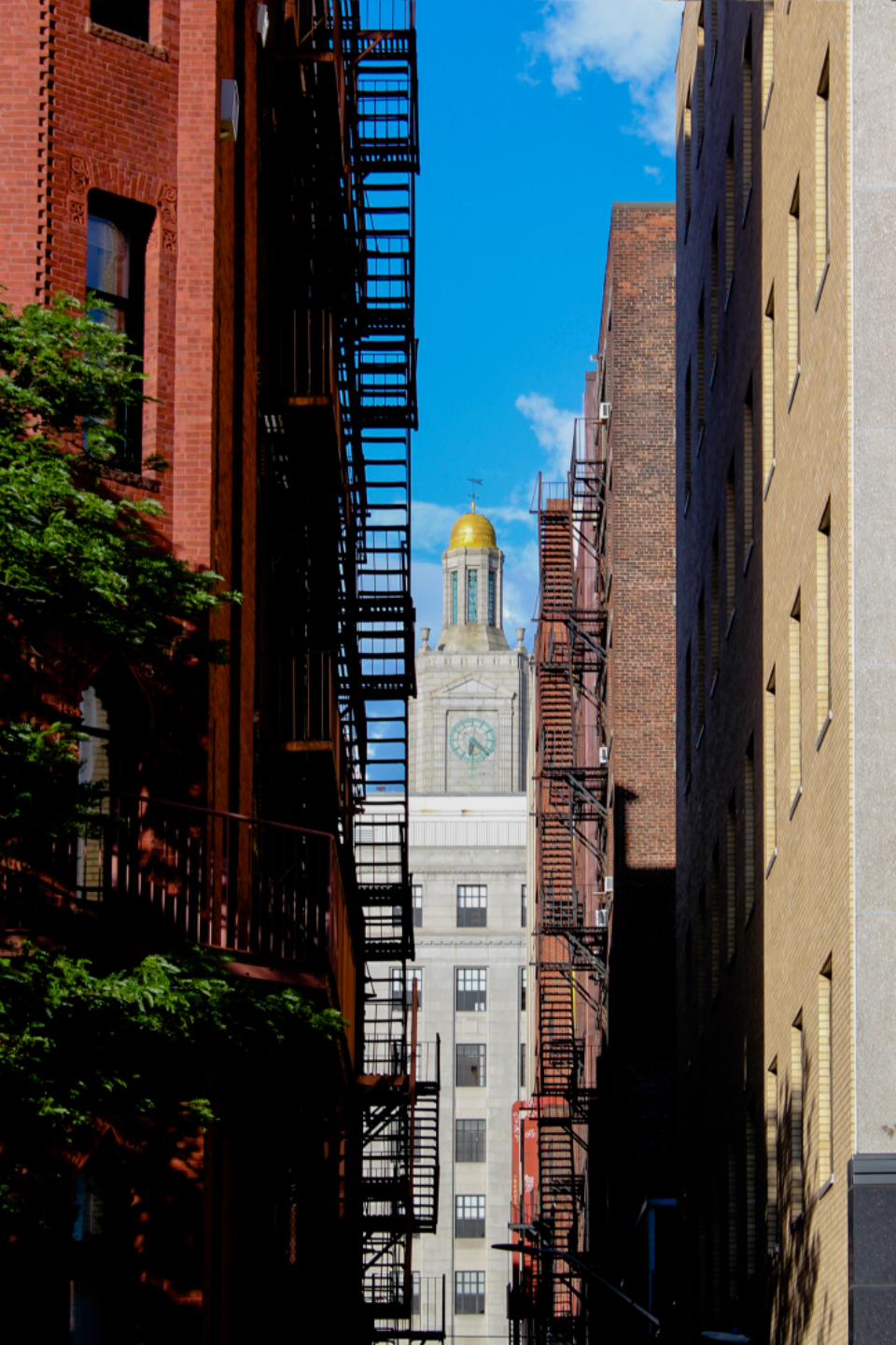 city fire escape buildings alley windows apartments sky clouds brick tall stairs narrow exterior architecture urban downtown