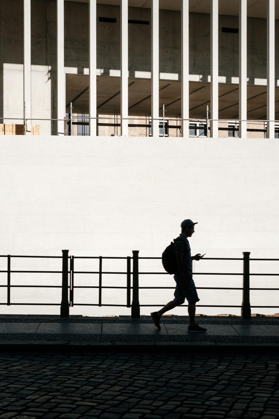architecture building infrastructure street outdoor people man guy male walking alone silhouette
