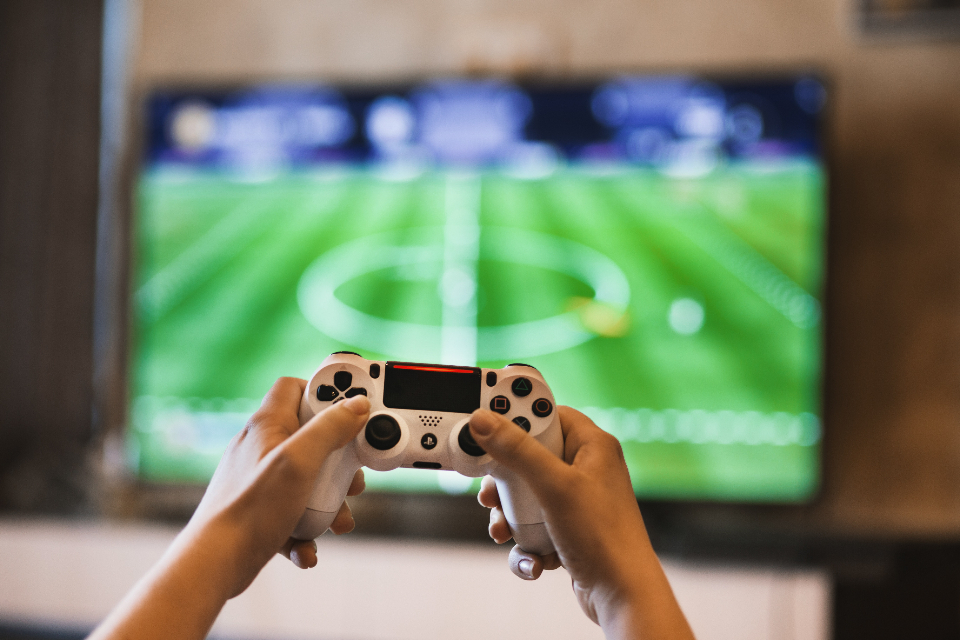 gamer controller television console football game fifa soccer hands