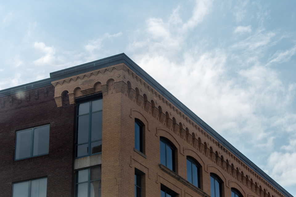 city building angle brick sky windows detail architecture structure office urban commercial corner wall old