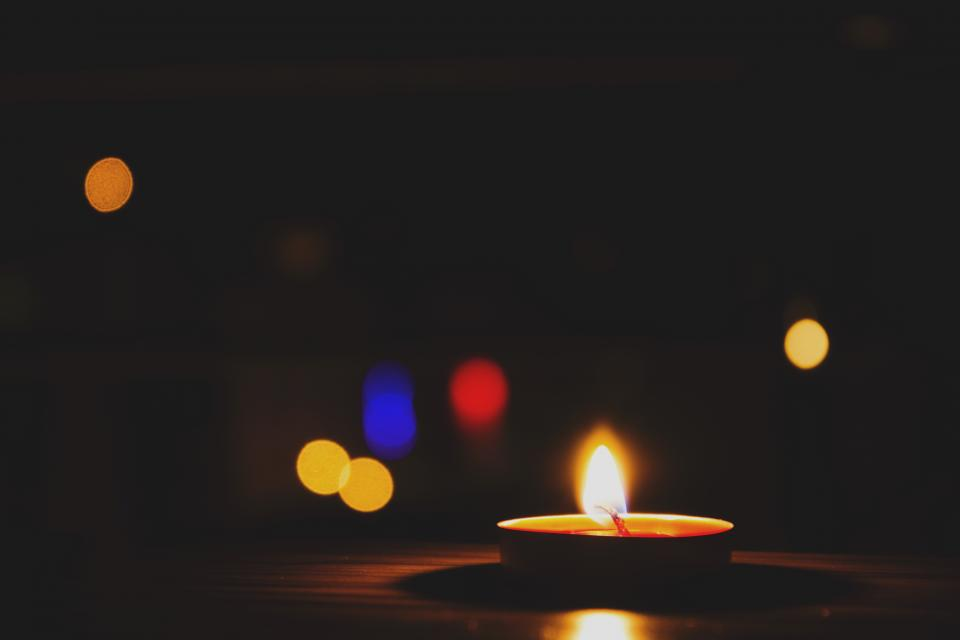dark night room bokeh light fire candle