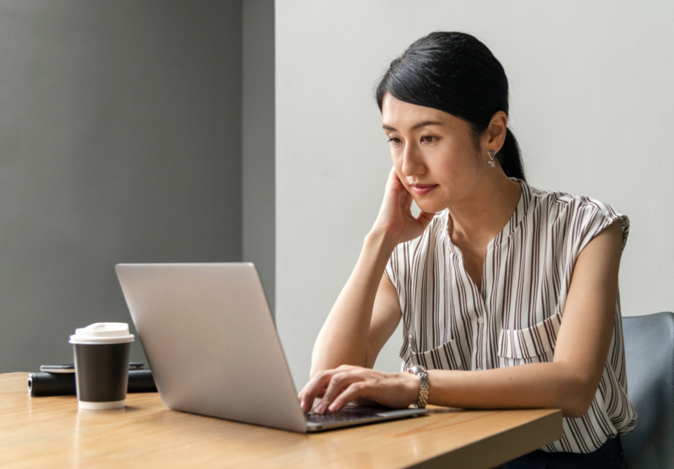 woman working laptop adult alone person computer reading typing casual coffee office workspace desk communication digital device female gadget internet media network sitting social media startup
