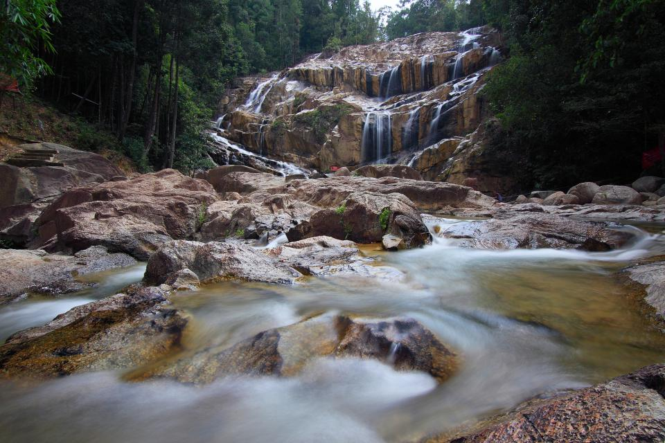 waterfall stream water spring nature rocks trees forest plants outdoor travel adventure