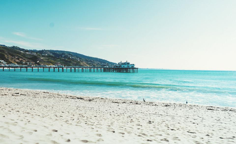 beach sand pier ocean sea summer sunshine sunny sky coast water tropical