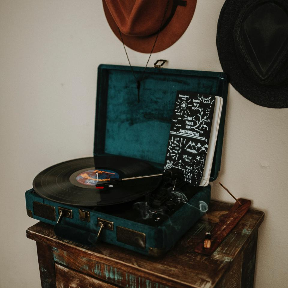 wall hats notes notebook smoke charcoal furniture music sounds old drawer vinyl player vinyl