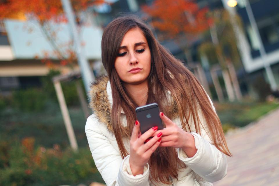young girl iphone cell phone mobile technology texting hands fingers nail polish long hair brunette people